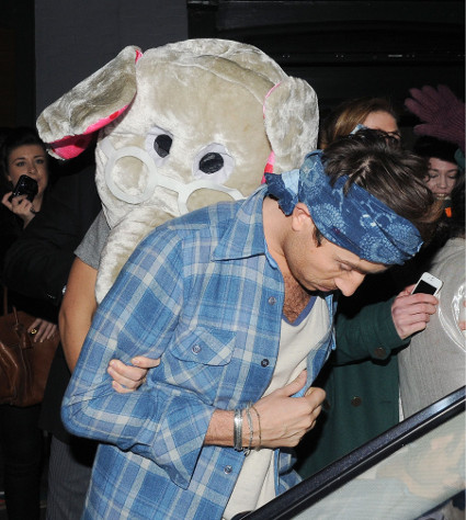 Harry Styles wears giant elephant mask leaving Groucho in London - Harry Styles images - sugarscape.com