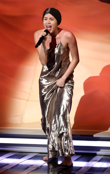 Miley Cyrus rocks a turban and glitzy gold maxi dress on X Factor - Miley Cyrus images - sugarscape.com