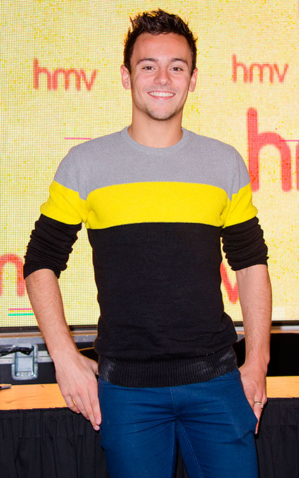 Tom Daley holds Tom Daley in photographic form at HMV Oxford Circus calendar signing - Images - Sugarscape.com