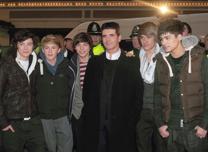 One Direction would quite like Simon Cowell to take them on holiday. Preferably to Barbados.