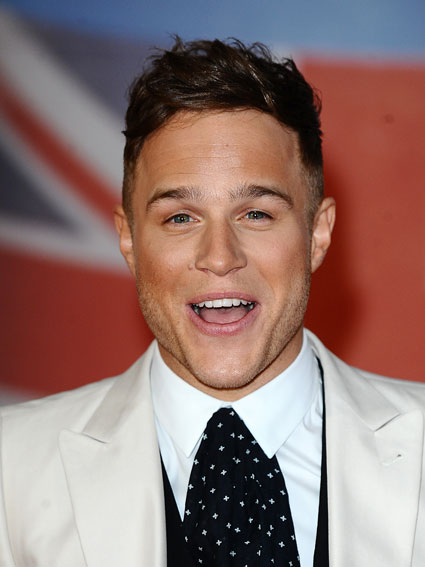 Olly Murs is hoping for some dating tips from One Direction in America