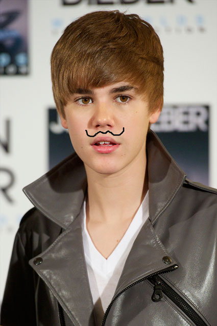 justin bieber mustache real. Justin Bieber has a laugh in a