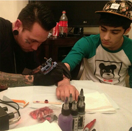 One Direction's Louis Tomlinson and Zayn Malik get new MSG Madison Square garden arm tattoo from Infinity tattooist John Baher in New York - PICS