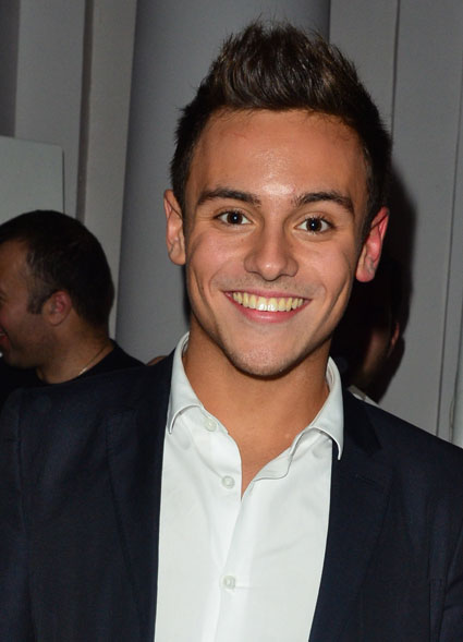 Tom Daley looks fit at Will.I.Am's app launch at London's One Marylebone - PICS
