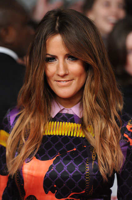Caroline Flack has been spotted kissing a male friend