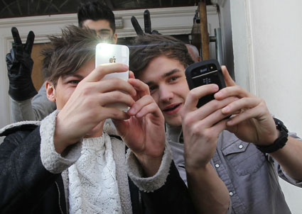 louis tomlisnon and liam payne from one direction playing papoftheweek outside radio 1