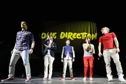 one direction on stage in toronto canada