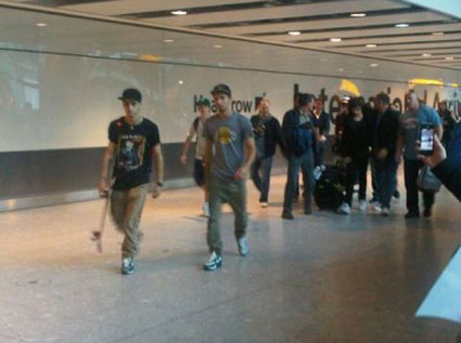 One Direction arrive home