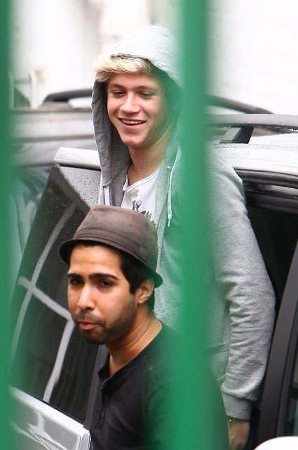 one direction's niall horan leaving a car at london recording studio august 2012