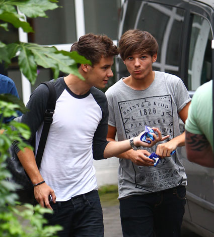 one direction's louis tomlinson and liam payne leaving a recording studio in london