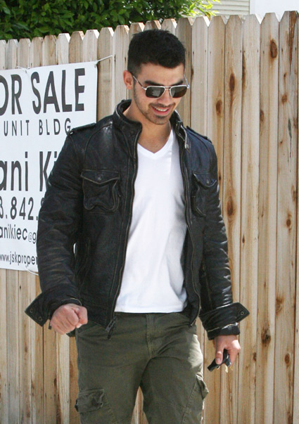 Joe Jonas smiling wearing sunglasses
