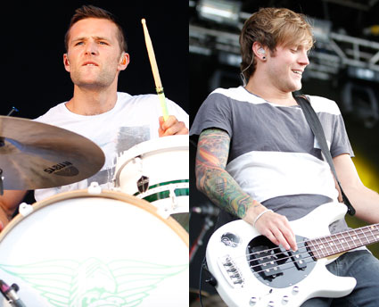 Harry Judd and Dougie Poynter performing at a racecourse