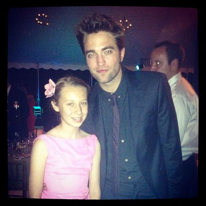 Robert Pattinson and Kristen Stewart at a wedding