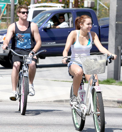 miley cyrus and liam hemsworth on bikes