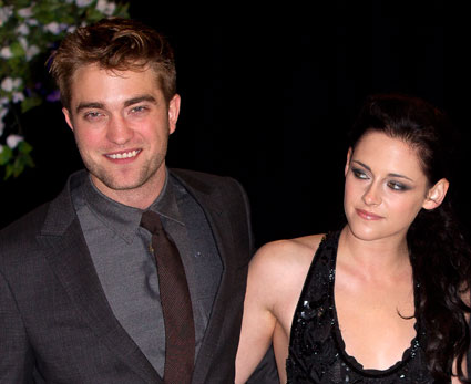 Robert Pattinson and Kristen Stewart PDA at Paris Fashion Week
