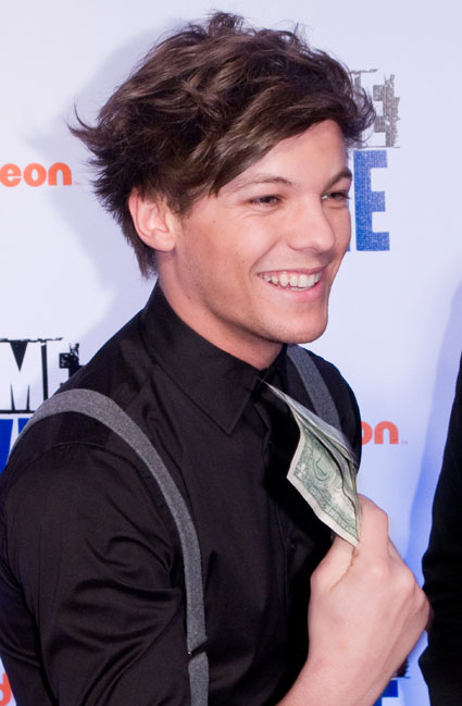 louis tomlinson from one direction at big time movie premiere with hand of dollars