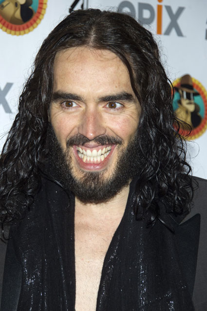 russell brand warrant out for arrest phone through window
