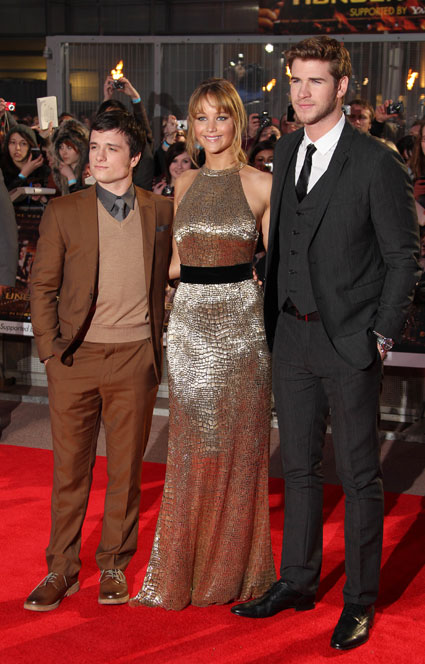 Josh Hutchersom, Jennifer Lawrence and Liam Hemsworth at The Hunger Games premiere