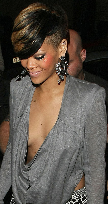 Check out Rihanna leaving a London club last night with her hair swept