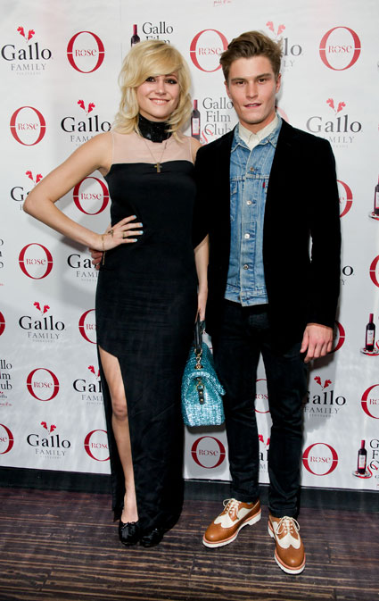 Pixie Lott in a black dress with boyfriend Oliver Cheshire