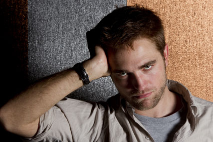 robert pattinson poses for portrait in cannes