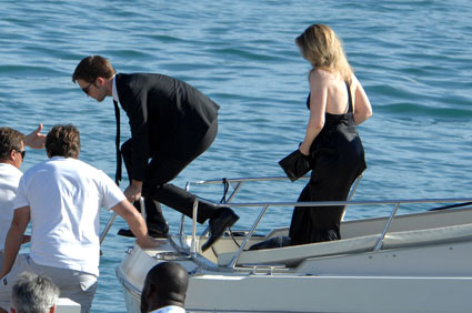 Robert Pattinson falls out of a boat on the way to Kristen Stewart's On The Road Cannes premiere