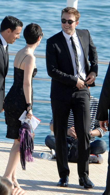 Robert Pattinson falls out of a boat on the way to Kristen Stewart's On The Road premiere at Cannes