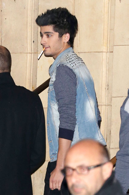 One Direction's Zayn Malik spotted smoking at the Royal Variety Performance - PICS