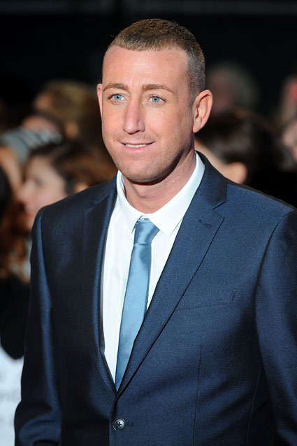 One Direction's Louis Tomlinson is not happy about Christopher Maloney still going through on the X Factor