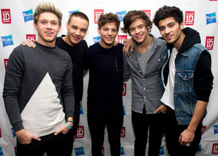 One Direction have a pose and play with their dolls in New York with X Factor USA's Rachel Crow - PICS