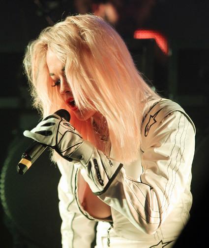 Rita Ora flashes boob at gig