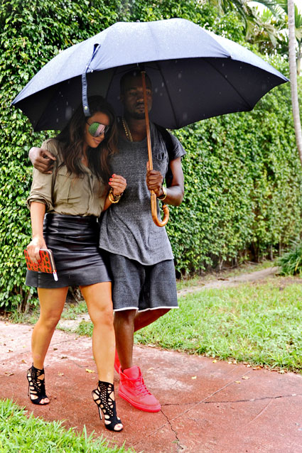 kim kardashian and kanye west in the rain