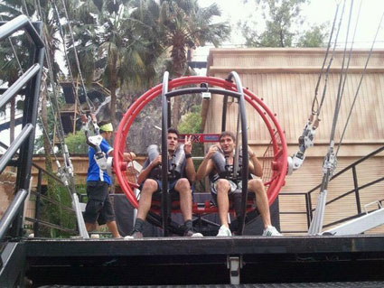 The Wanted's Tom Parker and Siva Kaneswaran go on a mental ride at a fairground in Malaysia - PICS