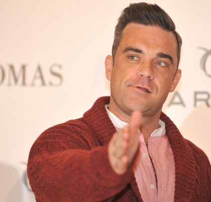 louis tomlinson invites robbie williams to join one direction