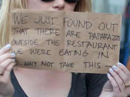 emma stone paparazzi sign