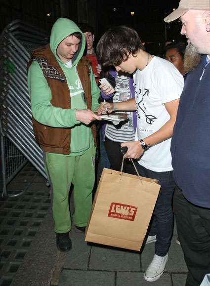 harry styles from one direction signing autographs outside nick grimshaw's radio 1 show london