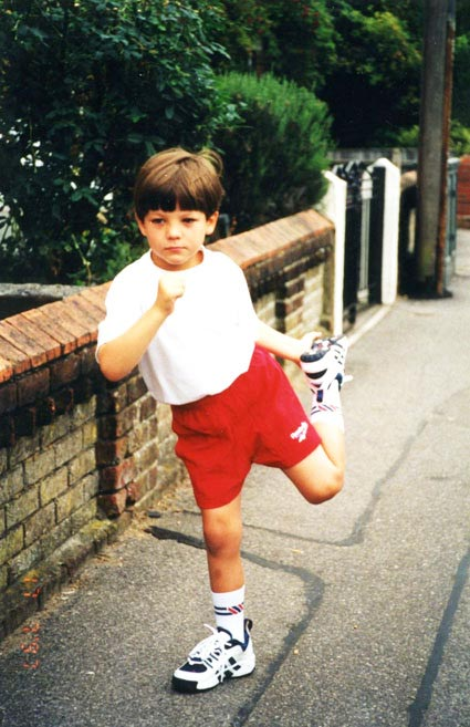 louis tomlinson as a baby in football shorts