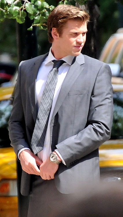 liam hemsworth in a suit on the set of philadelphia