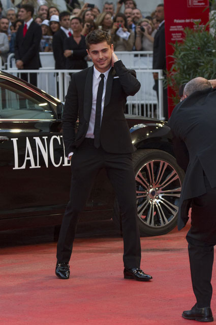 zac efron at venice film festival in a suit