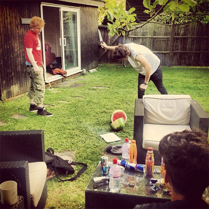 One Direction and Ed Sheeran spend the day in the studio,<br /> playing real life fruit ninja and apparently recording for a<br /> documentary