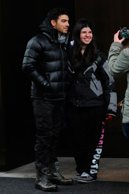 Joe Jonas posing for photos with fans outside his hotel in New York, 22nd January 2012