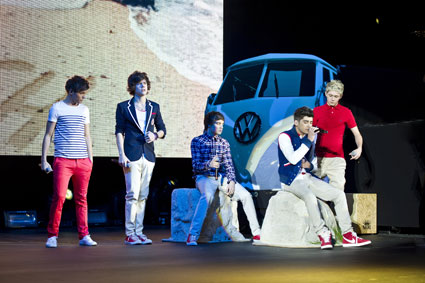 One Direction on stage with VW camper van in London