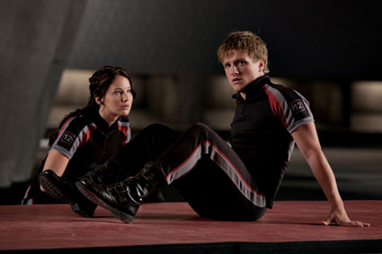 Katniss and Peeta in matching outfits, still from The Hunger Games