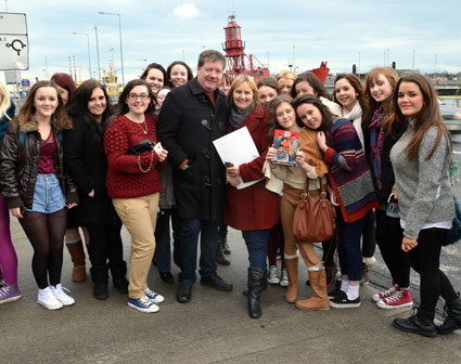 Liam Payne from One Direction's parents posing with fans