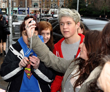 Niall Horan from One Direction posing with fans in Dublin