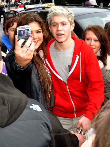 One Direction's Niall Horan posing with fans in Dublin
