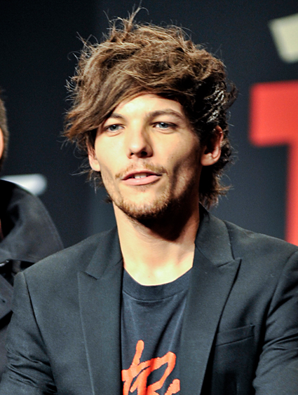 The 26-year old son of father Troy Austin  and mother Johannah Poulston, 175 cm tall Louis Tomlinson in 2018 photo